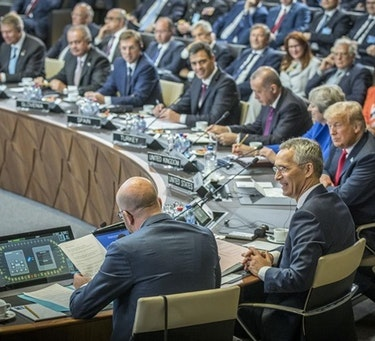 Secretary General of NATO, Jens Stoltenberg, leading a session during the NATO Summit in Brussels in July 2018